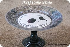 DIY Cake Plate Stand w/ Scrapbook Paper, Mod Podge, Paint and E6000 glue.
