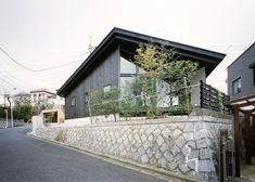 MDS designs blackened timber house on a sloping junction in Tokyo