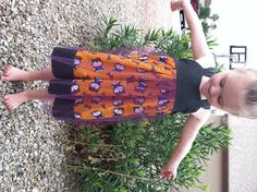 This the simple and sweet Ella dress with a Halloween twist, Comfy and casual to wear all October long This dress features a wide skirt with a tulle skirt over it to add a touch of spookiness. This dress has adjustable straps that are tied in a sweet bow in the back.  This is a made to order dr...