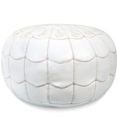 We love this Moroccan-inspired leather pouf for a bedroom or living area. | $239.99