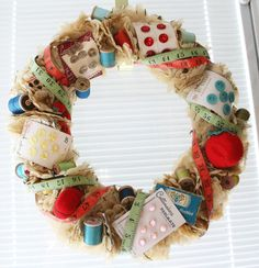 I doff my cap to the creator of this fantastically lovely/cool/clever sewing notion filled wreath (which I'm smitten with!). #crafts #wreath #sewing #supplies #vintage #clever