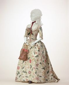 """Dress (robe à l'anglaise) c. 1785 (fabric: 1760s)-England.  White china silk with polychrome painting in plant motif; """"compères"""" front; boned at center back; matching petticoat. Kyoto Costume Institute"""