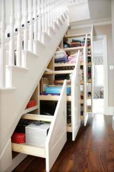 sliding shelves underneath staircase! graduated height gives tons of #storage room!