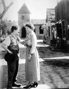 Charlie Chaplin meets Helen Keller.