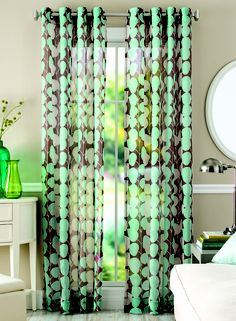 The beautiful and easy-to-hang Vine Curtain Panel adds a soft touch to your home, while letting in natural light.
