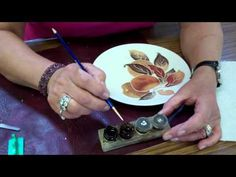 This video lesson shows Jackie Halhead, UK demonstrating how to gild I-Relief that she has trailed onto the surface of a plaque and then fired! porcelain paint, paint appli, jacki, china paint, brushes, bright gold, chinapaint, appli liquid, paint porcelain