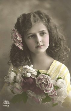 Tinted picture of very pretty young girl with bouquette of flowers
