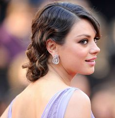 To achieve the faux bob as Mila Kunis, curl as many locks as you can then start the pinning process.