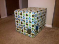 """DIY Litter box cover - Incredibly easy and cheap! VERY useful if you have dogs that will not stay out of the litter box!  Use a cardboard box and fabric.   Cut out small holes for """"doors"""" on the sides of the box and leave a larger opening in the backside to take out the litter box to empty it. Cover with 1.5 yards of fabric. Cost less than $7!"""