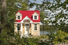 a tiny red-roofed cottage. See the post for interior pictures. it is delightful!