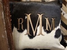 Monogrammed cowhide pillow- i die. @Samantha @AbdulAziz Bukhamseen Home Sweet Home Blog @عبدالعزيز الجسار Bukhamseen Home Sweet Home Blog Blythe I thought of you