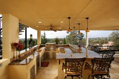 Large outdoor kitchen with a roof.  Seems like an extension of the home!
