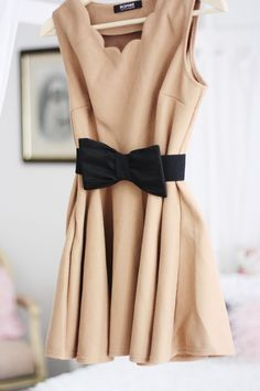 nude & black with cinched waist & a scalloped neckline