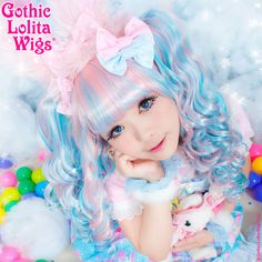 Gothic Lolita Wigs® Baby Dollight™ Collection - Pink & Blue Blend – Dolluxe® Baby Dollight™ Collection - Pink & Blue Blend  Babydoll style comes with a curly base wig and two matching ponytails. It is super thick with matching ponytails designed along with the base wig to blend seamlessly. Be fun and fluffy in this delectable Cotton Candy blend of pink and blue hair. #gothiclolitawigs #GLW #IAMDOLLUXE #wig #coolhair #hairfashion #style #hairstyle #beautiful #pretty #pastel #pink #blue