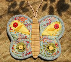 Butterfly Pot HOlder by Patchwork Pottery---soooo cute!