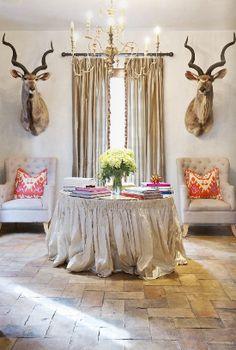 stone floors skirted silk round table and dear mounts.