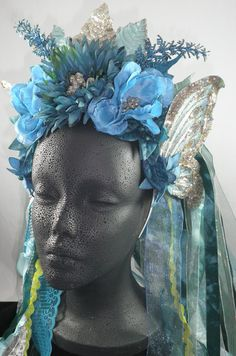 Teal Mint Silver Glitter Fantasy Butterfly Faerie Floral Headpiece. $ 50.00, via Etsy.