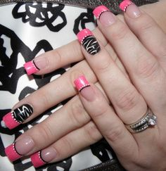 Pink, black and white nails with zebra detail