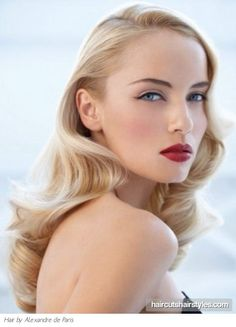 Old Hollywood Hair and makeup-pin curl waves or Victory rolls; Neutral on the eye with a winged liquid liner and dramatic red lip.