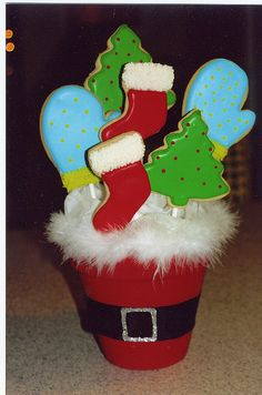 Santa Cookie Bouquet--use craft styrofoam, individually wrap each cookie pop and then basket wrap the basket...good idea for mother's day too.