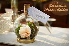 christmas bulb + moss + flowers + wine cork + mason jar lid = table top terrarium!