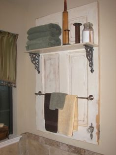 Old door cut down to size, add a shelf and towel bar