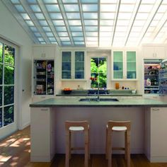 A translucent roof made of aluminum-and-fiberglass Kalwall panels turns this kitchen into a giant light box.