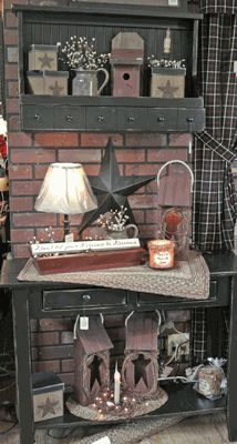 Rustic Country...love the black cupboard & table with the star & birdhouses.