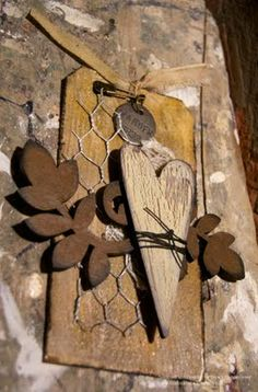 Altered tag, chicken wire, heart, metal tag, leaves.