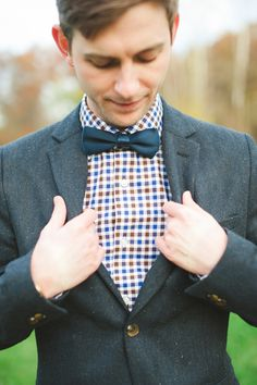 checked shirt and bow tie, photo by Colagrossi Studios http://ruffledblog.com/winona-lake-elopement #grooms #bowties