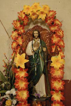 A floral tribute surrounds Saint Jude in the church of San Felipe de los Herreros, Michoacan, Mexico