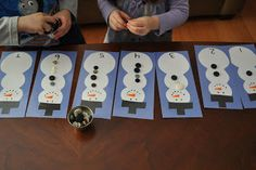 A fun center for learning counting and number recognition. Put the right number of buttons onto the snowman.