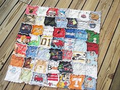 Quilt made out of onesies from baby's first year. What a sweet idea!