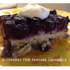 Double the THM E Pancake Batter pg. 223. Add 4 tsp of THM Sweet Blend, 1 tsp of Almond Extract, 2 tsp vanilla to the pancake batter. Cook down the frozen blueberries in 1 1/2 cups of water & 2 tsp of THM Sweet Blend for about 30 mins. Pour off & save the extra juice from the blueberries. Spray a 9x13 pan, pour blueberries down first then pancake batter on top. Baked 35-40 mins for 350 degrees. Run knife around edge & flip over. Cut into 12 squares! I love the THM batter! Soooo versatile!