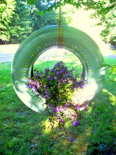 I found this tire in the woods and I spray painted it, added garden glass and filled with flowers, Try it.