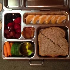 Blackberries, strawberries, and grapes, carrots and cucumbers w/oil and vinegar dip, clementine, ham & cheese on Ezekiel Bread, and apricot fruit leather hearts!