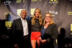 Stephen Hawkins, Colbie Caillat and Amnesty USA board chair Ann Burroughs.