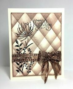 handmade card ... monochromatic brown ... luv the background technique ... sponged off edge of mask to create a shades harlequin pattern ... silhouette wildflowers ... lovely bow ..