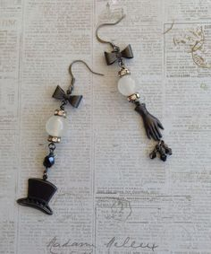 Asymmetrical Earrings for the August Challenge .. Perfect for one of those special Black Tie Events .. Bow Ties, Black Top Hat and Black Glove are from B'sue Boutiques .. I love the way these turned out .. Designed by Jann Westlake Tague .. Clever Designs .. https://www.facebook.com/JewelsByJann
