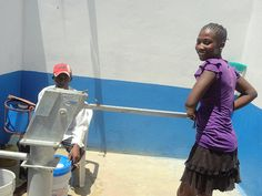 Pumping water from a new well in Haiti.