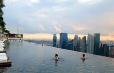 Infinity pool overlooking the skyline at the Marina Bay Sands Resort in Singapore. I wanna go someday!