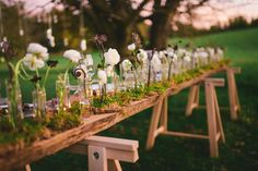 Eco-inspired wedding shoot by Kate Ignatowski with lovely, natural floral arrangements and rustic tables
