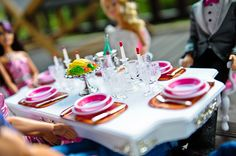 Barbie and Ken's table at the reception, so cute!