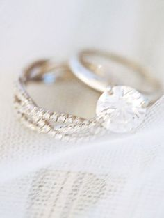 simple engagement ring band and three-band diamond wedding band.