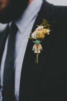 Lego Yoda boutonniere! photo by Red White & Green Photography http://ruffledblog.com/swansboro-backyard-wedding #boutonniere #yoda #whimsy