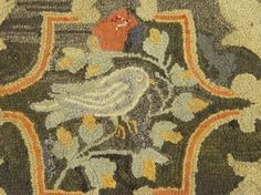 "19th c. hooked rug with bird center. 28 1/2"" x 60"""