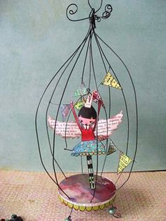 Bird cage made from florist wire and little fairy inside  maybe a jar lid for the bottom?