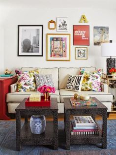 Colorful Eclectic Living Room.  Love the gallery wall, the pillows and the 2 small tables used as a coffee table!!!