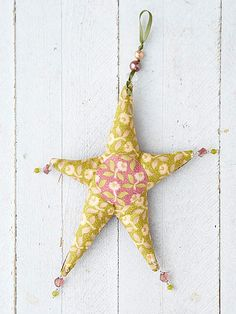 We've used fun fabric, ribbon and beads to make this Winter Jewel Star Ornament.