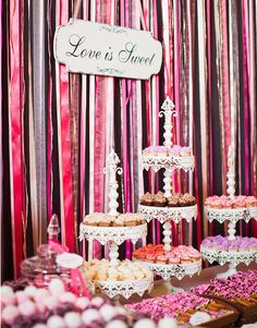 Dessert table backdrop made of ribbons. #Reception #Celebstylewed. @Celebrity Style Weddings